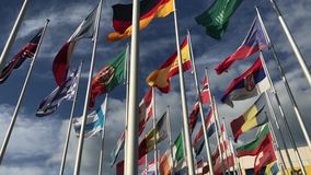 Flags of many countries vawing in the wind with blue sky and white clouds. for political, international trade, relationship concep