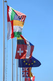 Flags of many nations in the wind on a sunny day Stock Images
