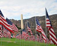 Flags In Memory of those who died in 9/11 attacts. The Cross of Pepperdine University, Malibu, California stands in the background of 2,977 flags in total–2 Royalty Free Stock Photography