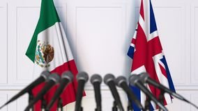 Flags of Mexico and The United Kingdom at international meeting or negotiations press conference. 3D animation stock footage