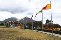 FLAGS IN MIDDLE OF THE WORLD, ECUADOR Stock Photo