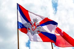 Flags of the Ministry of defense and Victory flag. Samara, Russia - May 9, 2019: Flags of the Ministry of defense and Victory flag against the sky royalty free stock photo