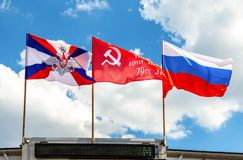 Flags of the Ministry of defense, Victory flag and State flag of the Russia. Samara, Russia - May 9, 2019: Flags of the Ministry of defense, Victory flag and stock photography