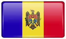 Flags Moldova in the form of a magnet on refrigerator with reflections light. Stock Photos