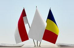 Flags of Monaco and Chad. Desktop flags of Monaco and Chad with white flag in the middle stock image