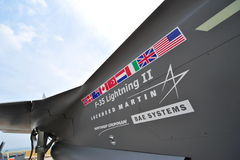 Flags and names printed on the side of Lockheed Martin, F-35 Lightning fighter jet at Singapore Airshow Royalty Free Stock Photography