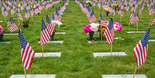 Flags at a National Cemetery. American flags and tombstones at an American National Cemetery Stock Photo