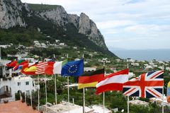 Flags of the Nations. Flags soaring across an italian landscape from countries around the world stock photography