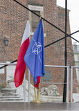 Flags of Nato and Poland outdoor closeup in Krakow, Poland. royalty free stock photo