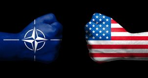 Flags of NATO and the United States painted on two clenched fist stock image