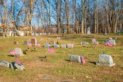 Flags near the headstones of United States war veterans stock photos