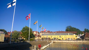 The flags of the Nordic countries. Flying in the city harbour in Sweden Stock Photos