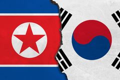 Flags of North Korea and South Korea painted on cracked wall royalty free illustration