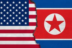 Flags of North Korea and USA painted on cracked wall. vector illustration