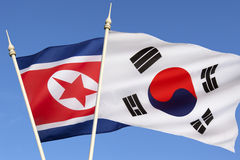 Flags of North and South Korea. The flag of North Korea was adopted on 8 September 1948, as the national flag and ensign of this isolationist Stalinist state Royalty Free Stock Photo