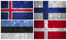 Flags of Northern Europe part 1. Iceland, Finland, Denmark and Estonia  flags of wall texture Royalty Free Stock Image