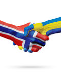 Flags Norway, Sweden countries, partnership friendship handshake concept. Royalty Free Stock Image