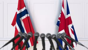 Flags of Norway and The United Kingdom at international meeting or negotiations press conference. 3D animation stock video