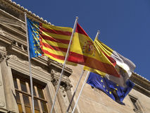 Flags - Orihuela - Costa Blanca - Spain. Flags of the Costa Blanca region, Spanish National flag, Vatican City flag and the flag of the European Union - Santo Stock Photos