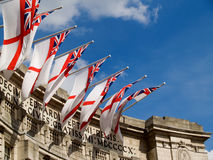 Flags over Admiralty Arch. English Navy flags flying over Admiralty Arch, The Mall, London Royalty Free Stock Image