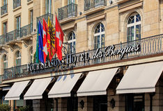 Flags over the entrance to the Four Seasons Hotel des Bergues in Geneva, Switzerland Stock Photography