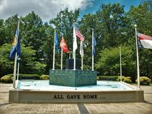 Flags over Veterans Memorial in King, North Carolina royalty free stock images