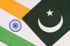 Flags of Pakistan and India divided diagonally stock illustration