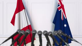 Flags of Peru and Australia at international meeting or negotiations press conference