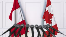 Flags of Peru and Canada at international meeting or negotiations press conference