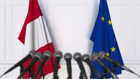 Flags of Peru and the European Union at international meeting or negotiations press conference
