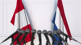 Flags of Peru and Netherlands at international meeting or negotiations press conference