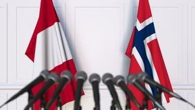 Flags of Peru and Norway at international meeting or negotiations press conference