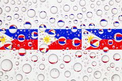 Water drops on glass and flags of Philippines Stock Image