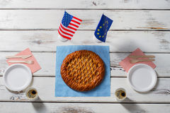 Flags beside pie and plates. Royalty Free Stock Photography
