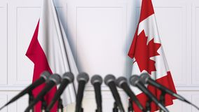 Flags of Poland and Canada at international meeting or negotiations press conference. 3D animation stock footage