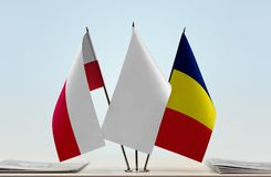 Flags of Poland and Chad. Desktop flags of Poland and Chad with white flag in the middle stock images