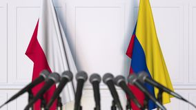 Flags of Poland and Colombia at international meeting or negotiations press conference. 3D animation stock video