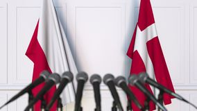 Flags of Poland and Denmark at international meeting or negotiations press conference. 3D animation stock video footage
