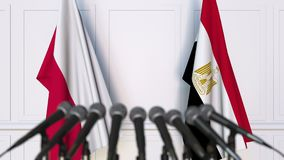 Flags of Poland and Egypt at international meeting or negotiations press conference. 3D animation stock video footage