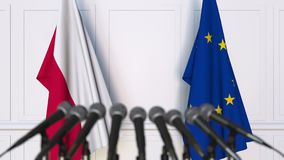 Flags of Poland and the European Union at international meeting or negotiations press conference. 3D animation stock video