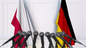 Flags of Poland and Germany at international meeting or negotiations press conference. 3D animation stock video footage