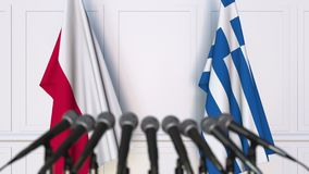 Flags of Poland and Greece at international meeting or negotiations press conference. 3D animation stock footage
