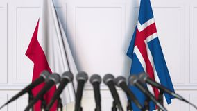 Flags of Poland and Iceland at international meeting or negotiations press conference. 3D animation stock video footage