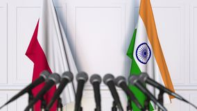 Flags of Poland and India at international meeting or negotiations press conference. 3D animation stock video footage
