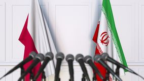 Flags of Poland and Iran at international meeting or negotiations press conference. 3D animation stock footage