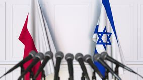 Flags of Poland and Israel at international meeting or negotiations press conference. 3D animation stock video