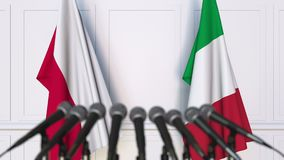 Flags of Poland and Italy at international meeting or negotiations press conference. 3D animation stock video