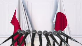 Flags of Poland and Japan at international meeting or negotiations press conference. 3D animation stock video