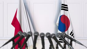 Flags of Poland and Korea at international meeting or negotiations press conference. 3D animation stock video footage