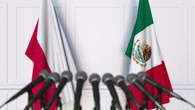 Flags of Poland and Mexico at international meeting or negotiations press conference. 3D animation stock video